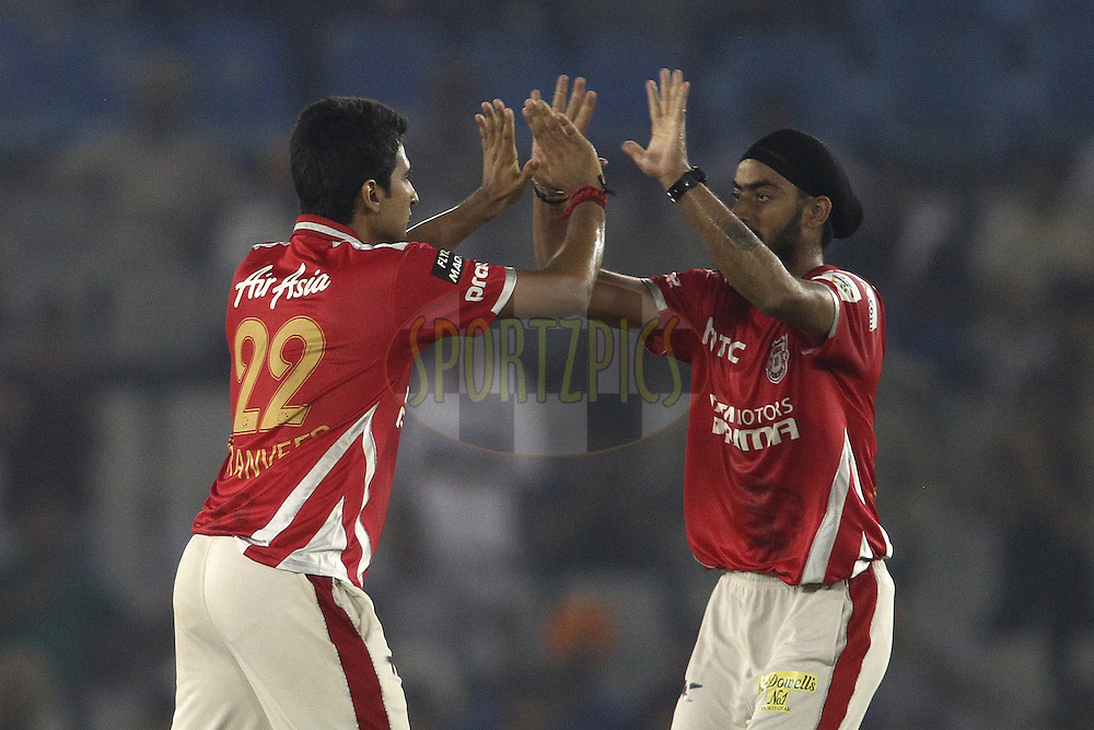 Karanveer Singh of the Kings XI Punjab is congratulated by Anureet Singh of the Kings XI Punjab for getting Shoaib Malik of the Hobart Hurricanes wicket during match 2 of the Oppo Champions League Twenty20 between the Kings XI Punjab and the Hobart Hurricanes held at the Punjab Cricket Association Stadium, Mohali, India on the 18th September 2014<br /> <br /> Photo by:  Shaun Roy / Sportzpics/ CLT20<br /> <br /> <br /> Image use is subject to the terms and conditions as laid out by the BCCI/ CLT20.  The terms and conditions can be downloaded here:<br /> <br /> http://sportzpics.photoshelter.com/gallery/CLT20-Image-Terms-and-Conditions-2014/G0000IfNJn535VPU/C0000QhhKadWcjYs