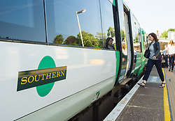 File photo dated 11/06/15 of a Southern rail train, as talks aimed at resolving a long-running dispute over the role of rail conductors are set to be held even though a strike is continuing.