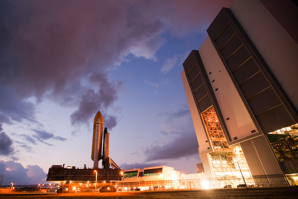 CAPE CANAVERAL, FL - OCTOBER 14:  Space Shuttle Atlantis, sitting on top of the crawler transporter, moves out of the vehicle assembly building and to launch pad 39-a at the Kennedy Space Center, October 24, 2009 in Cape Canaveral, Florida. Atlanits is making the 3.5-mile journey in preparation for its launch next month to the International Space Station.  (Photo by Matt Stroshane/Getty Images)