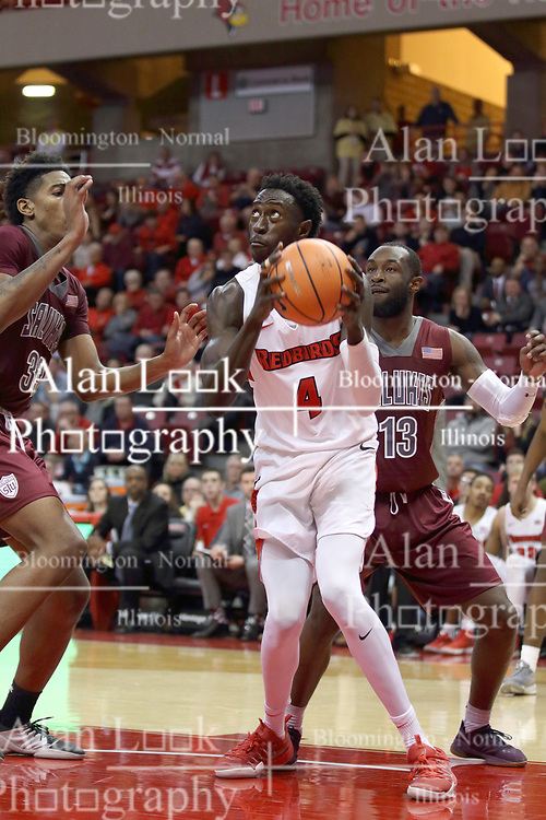 """08 February 2018:  While doubled and cornered by Kavion Pippen and Sean Lloyd Jr., Daouda """"David"""" Ndiaye looks for the hoop during a College mens basketball game between the Southern Illinois Salukis and Illinois State Redbirds in Redbird Arena, Normal IL"""