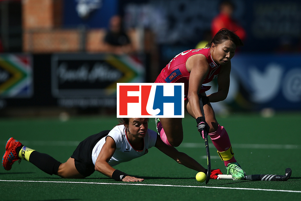 JOHANNESBURG, SOUTH AFRICA - JULY 14:  Yukari Mano of Japan and Marlena Rybacha of Poland battle for possession during day 4 of the FIH Hockey World League Semi Finals Pool B match between Poland and Japan at Wits University on July 14, 2017 in Johannesburg, South Africa.  (Photo by Jan Kruger/Getty Images for FIH)