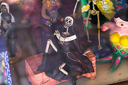 Dead nun smoking a cigarette on Olvera Street in LA.