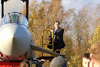 """03 NOV 2003, LAAGE/GERMANY:<br /> Gerhard Schroeder, SPD, Bundeskanzler, klettert aus dem Cockpit eines Eurofighter EF 2000 """"Typhoon"""", hier in der zweisitzigen Ausbildungsversion, dem neuen Jagdflugzeug der Bundesluftwaffe, im Rahmen eines Besuches der Luftwaffe, Jagdgeschwader 73 """"Steinhoff"""", Fliegerhorst Laage<br /> IMAGE: 20031103-01-049<br /> KEYWORDS: Bundeswehr, Bundesluftwaffe, Jet, Kampfflugzueg, Gerhard Schröder"""