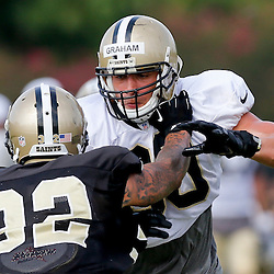 Aug 3, 2013; Metairie, LA, USA; New Orleans Saints tight end Jimmy Graham (80) works against strong safety Kenny Vaccaro (32) during a scrimmage at the team training facility. Mandatory Credit: Derick E. Hingle-USA TODAY Sports