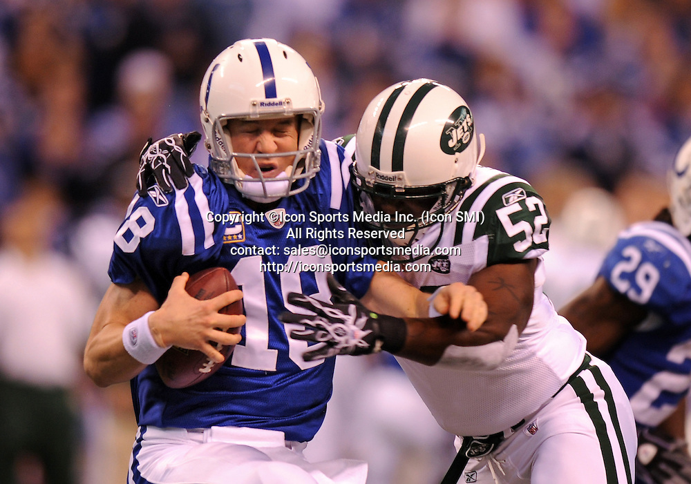January 24, 2010: New York Jets at Indianapolis Colts AFC Championship game at Lucas Oil Stadium in Indianapolis, IN: Indianapolis Colts quarterback Payton Manning is sacked by New York Jets David Harris in the first quarter of the AFC Championship game. PHOTO BY:Anthony J. Causi