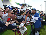 Jan 23, 2019; Kissimmee, FL, USA; New York Giants running back Saquon Barkley (26) signs autographs and poses for photos with fans after NFC practice for the 2019 Pro Bowl at ESPN Wide World of Sports Complex. (Steve Jacobson/Image of Sport)