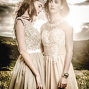 Conceptual fashion and fine art portraits taken by Janelle Pietrzak aka Explored Exposure. Models Tiana Perry and Courtnay Edwards, make up by Mallee Gambuti. Images depict two queens in a field, they are wearing silver and gold crowns and dresses.