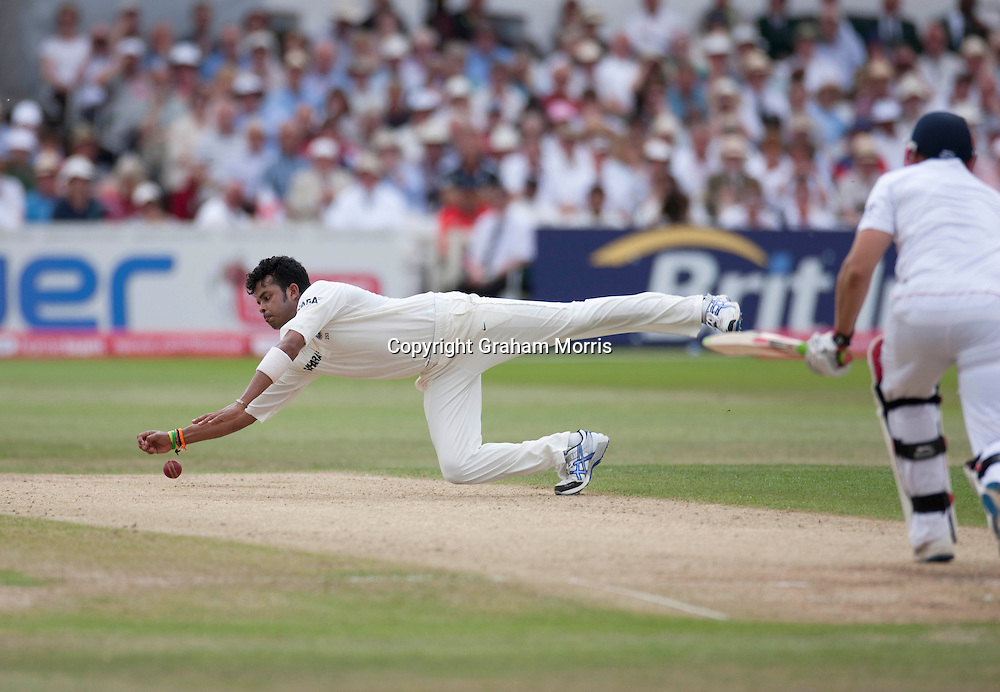 Sreesanth fields off his own bowling during the second npower Test Match between England and India at Trent Bridge, Nottingham.  Photo: Graham Morris (Tel: +44(0)20 8969 4192 Email: sales@cricketpix.com) 01/08/11
