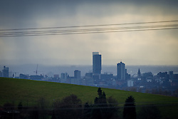 © Licensed to London News Pictures . 20/02/2014 . Manchester , UK . Landscape view across Manchester taken from Saddleworth near Oldham , featuring the city's iconic Beetham Tower in the centre and the Piccadilly Tower and Town Hall  to its right . Photo credit : Joel Goodman/LNP