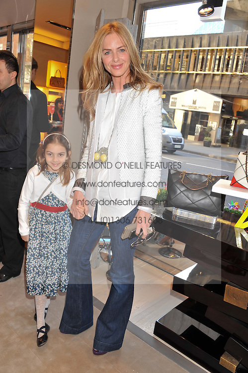 TRINNY WOODALL and her daughter LYLA at a fun filled tea party hosted by Roger Vivier to view their Jeune Fille collection of shoes in aid of Mothers4Children held at Roger Vivier, Sloane Street, London on 27th March 2012.