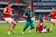 Swansea City forward Andre Ayew (22) and Barnsley defender Aapo Halme (24) in action during the EFL Sky Bet Championship match between Barnsley and Swansea City at Oakwell, Barnsley, England on 19 October 2019.