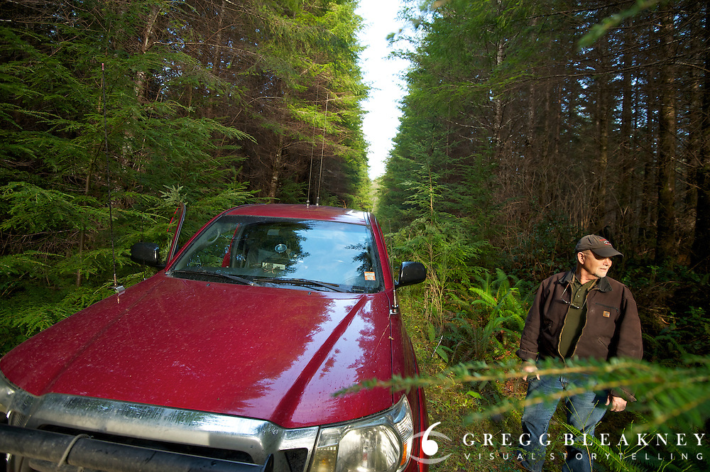 Jim Furabotten - On a small backroad typical of his patrol territory--listens for machete and/or chainsaw activity from illegal poachers.  - Olympic Peninsula, WA State<br />