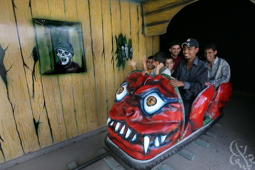 Iraqi teens exit the haunted house ride at the Fun City amusement park May 06, 2005 in Baghdad, Iraq.  Many Iraqis spend their Friday afternoons with family and friends or running personal and family errands.