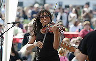 Warwick, New York - Singer E'lissa Jones and her group perform for a crowd in a park during the Applefest harvest celebration on Oct. 3, 2010.