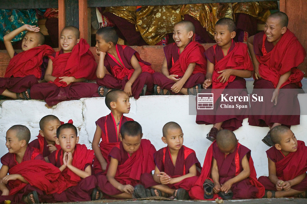 Young monks watching Tshechu Festival celebration at Wangdue Phodrang Dzong, Wangdi, Bhutan