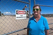 """Shirley McNall, who goes by Sugar in front of a fracking industry site near her home in Aztec New Mexico. She takes visitor interested in learning about what fracking has done to her neighborhood  on a 'Toxic tour"""". She takes them to numerous fracking industry sites in the San Juan Basin."""