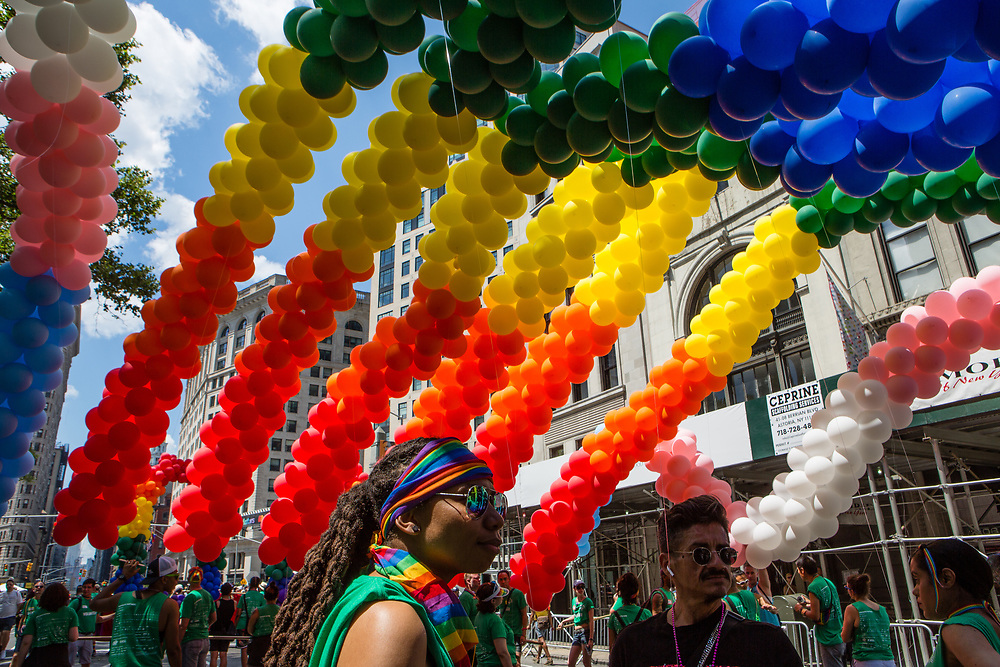 New York, NY - 30 June 2019. The New York City Heritage of Pride March filled Fifth Avenue for hours with participants from the LGBTQ community and it's supporters. Under the rainbow balloon arch prior to the start of the march.