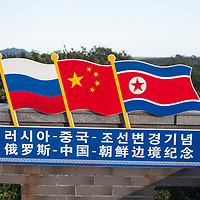 HUNCHUN, 09/12/2017:<br />  The RUssian, Chinese and North Korean national flags are displayed at a viewpoint at the border in Fangchuan.