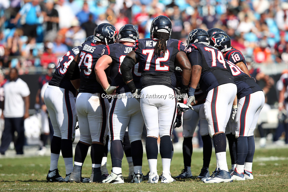 The Houston Texans offense huddles during the 2015 NFL week 2 regular season football game against the Carolina Panthers on Sunday, Sept. 20, 2015 in Charlotte, N.C. The Panthers won the game 24-17. (©Paul Anthony Spinelli)