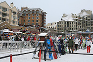 Crowds of skiers fill plaza at base of Whistler Mountain; Whistler, British Columbia, Canada