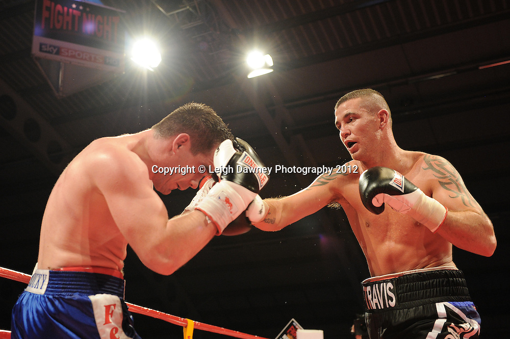 Travis Dickinson defeatsd Jevgenijs Andrejevs in a 8x3 Light Heavyweight contest at the Aintree Equestrian Centre, Liverpool on the 19th May 2012. Frank Maloney Promotions © Leigh Dawney Photography 2012.Travis Dickinson (black shorts) defeats Jevgenijs Andrejevs in a 8x3 Light Heavyweight contest at the Aintree Equestrian Centre, Liverpool on the 19th May 2012. Frank Maloney Promotions © Leigh Dawney Photography 2012.