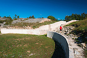 Vistor exploring the Burnum Roman Amphitheater ruins, Krka National Park, Dalmatia, Croatia