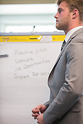 Andrew Smith, a sophomore business student, writes down reasons to go to a career fair during an exercise at the College of Business How to Meet the Firms interactive student workshop on Sept. 6, 2016. Photo by Emily Matthews