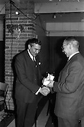 06/04/1963<br /> 04/06/1963<br /> 06 April 1963<br /> Staff presentations to Mr. John D. Ware, departing General Manager of W.D. & H.O. Wills Ireland. Senior staff made presentations of gifts to Mr. Ware at a party at the Zoo, Dublin. Mr. Ware was about to go to Bristol to take up the job of Assistant to W.S.J. Carter who was succeeding to the post of Managing Director of the Firm. Mr. Ware, on left, being presented with Ronson metalware.