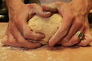 "Hands of a baker kneading dough in a bakery at night. This image was part of a photo exhibition ""Let there be Bread"" by Oren Shalev in the Eretz Israel Museum in Tel Aviv, Israel. The motif of the exhibition was bread. Such a basic food yet so complex and diverse. The images were produced by following the nightly work at a bakery from start to finish. To view all images from this exhibition please search for breadexhibition"