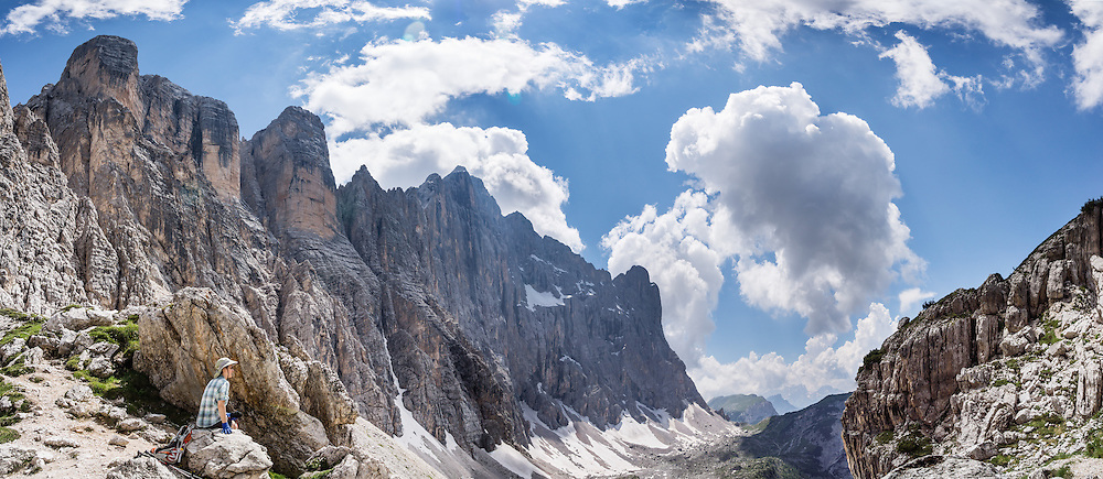 Monte Civetta (3220 meters or 10,564 feet elevation) rises high above hiker trails accessible via lift from Alleghe resort village, in the Dolomites, Belluno province, Veneto region, Italy. The Dolomites or Dolomiti are part of the Southern Limestone Alps in Europe. UNESCO honored the Dolomites as a natural World Heritage Site in 2009. This panorama was stitched from 6 overlapping photos.