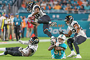 Aug 22, 2019; Miami Gardens, FL USA;  Jacksonville Jaguars wide receiver Keelan Cole (84) returns a punt and tries to avoid a tackle from Miami Dolphins defensive back Cornell Armstrong (31) during an NFL preseason game at Hard Rock Stadium. The Dolphins beat the Jaguars 22-7. (Kim Hukari/Image of Sport)