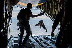 180928-M-TT434-085<br /> MIRAMAR, Calif. (Sept. 28, 2018) U.S. Navy Leap Frogs and U.S. Army Golden Knights jump out of a K-C130T Hercules aircraft during the 2018 Marine Corps Air Station Miramar Air Show on MCAS Miramar, Calif., Sept. 28, 2018. This year's air show honors 100 years of women in the Marine Corps by featuring several performances and displays that highlight accomplishments and milestones women since the first female enlistee, Opha May Johnson, who joined the service in 1918. (U.S. Marine Corps photo by Lance Cpl. Christian M. Garcia/Released)