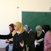 Veiled Jordanian students vote during student elections at the Faculty of Educational Sciences at the University of Jordan in Amman. Across the Middle East, young people are using religion to defy the status quo and challenge their governments. December 2008.