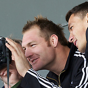 Ali WIlliams, (left) and Sonny Bill Williams, New Zealand, look at photographs taken using a photographer camera during All Black's training at Smart Stadium, Auckland, in preparation for the Rugby World Cup Final against France at the IRB Rugby World Cup tournament, Auckland, New Zealand. 18th October 2011. Photo Tim Clayton...