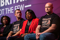 © Licensed to London News Pictures. 26/09/2018. Liverpool, UK. Shadow Home Secretary Diane Abbott MP (centre) with two representatives from the Fire Brigades Union on stage during Jeremy Corbyn's closing speech at the Labour Party Conference. Photo credit: Rob Pinney/LNP
