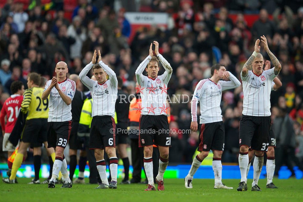 MANCHESTER, ENGLAND - Sunday, January 9, 2011: Liverpool's Jonjo Shelvey, Fabio Aurelio, Lucas Leiva and Martin Skrtel applaud their side's travelling supporters after the FA Cup 3rd Round match at Old Trafford. (Photo by: David Rawcliffe/Propaganda)