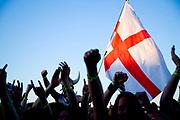 English flag above crowd at metal concert.<br /> Bloodstock Outdoor festival, UK. 16/07/06