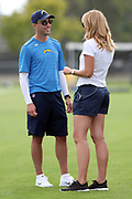 Los Angeles Chargers general manager Tom Telesco talks to NFL Network sideline reporter Alex Flanagan during the Los Angeles Chargers NFL football training camp practice on Sunday, July 30, 2017 in Costa Mesa, Calif. (©Paul Anthony Spinelli)