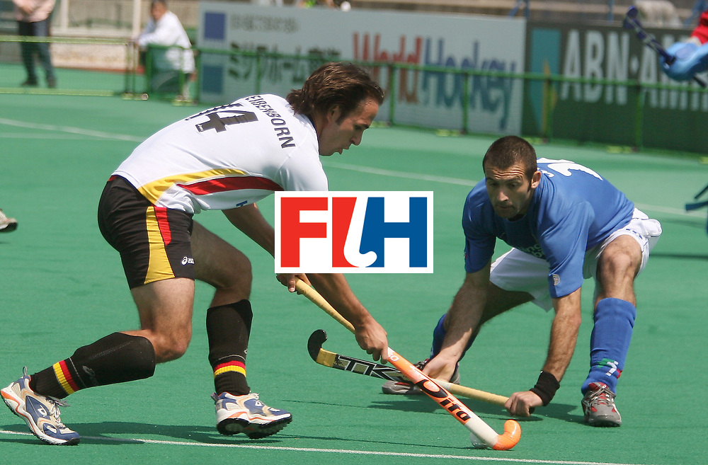 Kakamigahara (Japan):  Weissenborn Tibor of Germany tries to go past Congiju Francesco of Italy in the Olympic Hockey Qualifier at Gifu Perfectural Green Stadium at Kakamigahara on 05 April 2008.  Photo: GNN/ Vino John