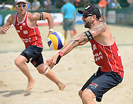 STARE JABLONKI POLAND - July 5: Clemens Doppler and Alexander Horst in action during Day 5 of the FIVB Beach Volleyball World Championships on July 5, 2013 in Stare Jablonki Poland.  (Photo by Piotr Hawalej)