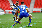 Featherstone Rovers centre Misi Taulapapa (4) in action  during the Challenge Cup 2018 match between Doncaster and Featherstone Rovers at the Keepmoat Stadium, Doncaster, England on 22 April 2018. Picture by Simon Davies.