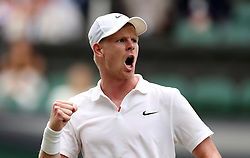 Kyle Edmund celebrates winning the first set against Jaume Munar on day one of the Wimbledon Championships at the All England Lawn Tennis and Croquet Club, Wimbledon.