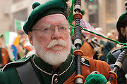 A piper from the County Armagh Association of New York.