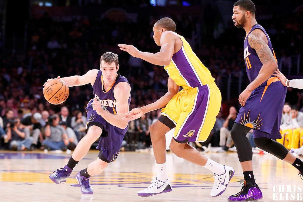04 November 2014: Phoenix Suns guard Goran Dragic (1) drives past Los Angeles Lakers forward Wesley Johnson (11) on a screen set by Phoenix Suns forward Markieff Morris (11) during the Phoenix Suns 112-106 victory over the Los Angeles Lakers, at the Staples Center, Los Angeles, California, USA.
