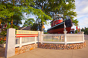 351021-1032G.Huey ~ Copyright: George H.H. Huey ~ Entrance to Mystic Seaport museum, with tugboat.   Mystic, Connecticut.