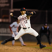 24 February 2018: The San Diego State Aztec baseball team competes in day two of the Tony Gwynn legacy tournament against #4 Arkansas. San Diego State Aztecs pitcher Adrian Mardueno (12) seen here pitching in the top of the ninth in a 2-2 tie game against Arkansas. The Aztecs dropped a close game to the Razorbacks 4-2. <br /> More game action at sdsuaztecphotos.com
