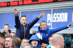 Two yound cardiff city fans chant at the Swansea City  Team as they arriva  at the ground.- Photo mandatory by-line: Alex James/JMP - Tel: Mobile: 07966 386802 03/11/2013 - SPORT - FOOTBALL - The Cardiff City Stadium - Cardiff - Cardiff City v Swansea City - Barclays Premier League