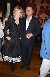 News presenter KIRSTY YOUNG and her husband NICK JONES at a party to celebrate the publication of Air Babylon by Imogen Edwards-Jones held at Fifty, 50 St.James's Street, London SW1 on 4th July 2005.<br />