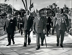 1965 - During the celebrations, President Kenyatta is pictured strolling through the famous Rose Garden at State House with (l to r) Emperor Haile Selassie of Ethiopia, Vice President Hussein Kulmie Afrah of Somalia and a bemedalled General Idi Amin Dada of Uganda. They are followed by other heads of delegations to the Anniversary celebrations. Credits: Camerapix (Credit Image: © Keystone Pictures USA/ZUMAPRESS.com)