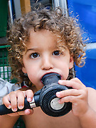 Young boy with a scuba diving mouthpiece in his mouth Model release available